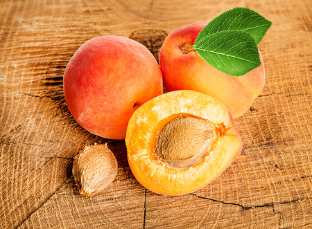 apricot kernel: Apricots on the wooden background