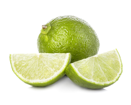 Lime. Whole lime with slices isolated on white background