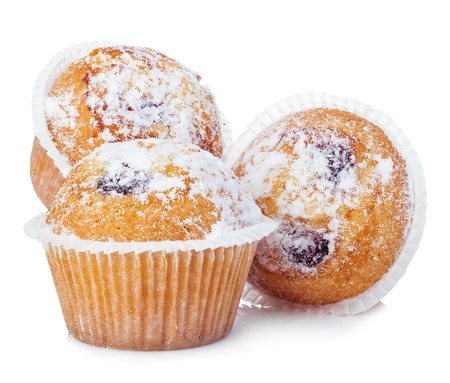 Blueberry muffins close-up isolated on a white background. Stock Photo
