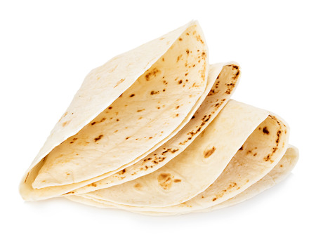 tortillas: Wheat round tortillas close-up isolated on a white background. Lavash. Stock Photo