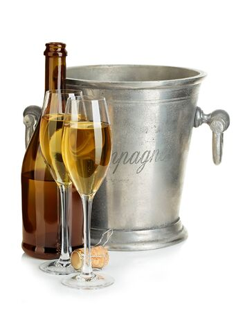 Champagne bottle with ice bucket and glasses of champagne isolated. Banque d'images