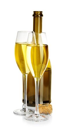 Two glasses of champagne on the  of brown bottles close-up isolated on a white. Banque d'images