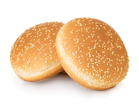 Two hamburger buns with sesame isolated on white