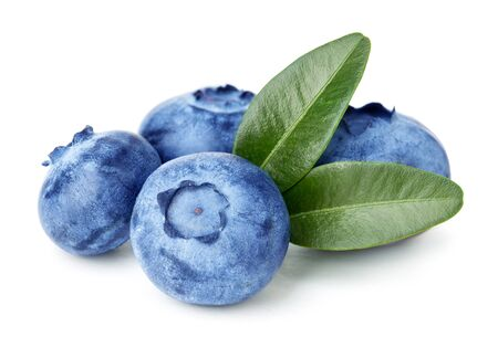 Blueberries with green leaves isolated on white