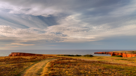 Path along the cliffs of Fatima in Cap-aux-Meules in Magdalen Islands, Quebec
