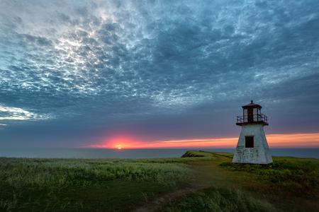 Sunrise over Cape Alright lighthouse at Havre-aux-maisons on Magdalen Islands, Quebec