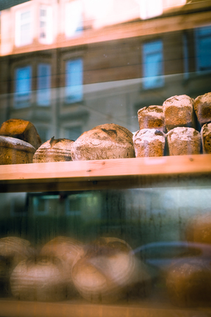 Loafs of Bread in the WIndow of a Small Bakery Shop