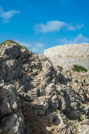 Rocky Steps on a Coastal Path With Bright Blue Sky, Balearic Islands Stock fotó