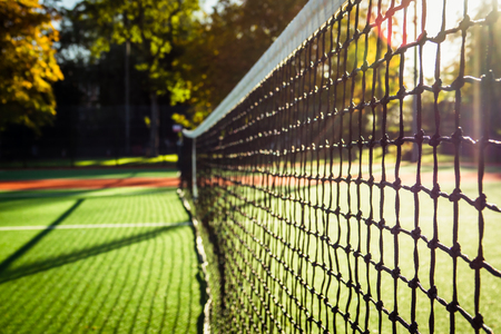 Closeup of a Tennis Net With the Grass Cours in the Background on a Sunny Morning Stock fotó