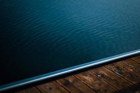 Edge of a Wooden Jetty With Dark Water