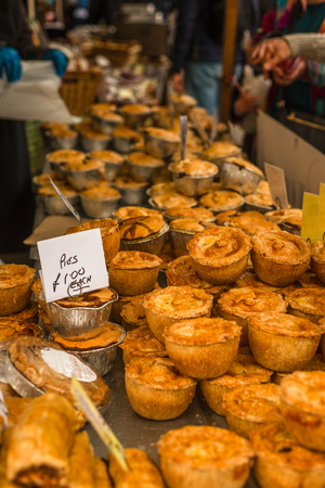 Pies for Sale at a Market Stall in England