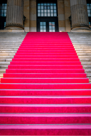 Red Carpet on the Stairs Leading to a Grand Event