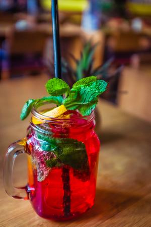 Raspberry Mocktail With Fresh Raspberries  and Mint and Lemon Garnish