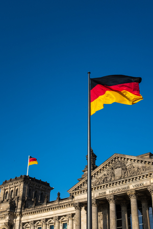 German Flags and Blue Sky at the Reichstag in Berlin