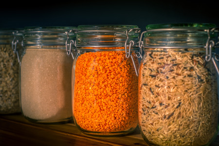 Jars of Dried Legumes and Wholegrain Rice in a Kitchen Pantry