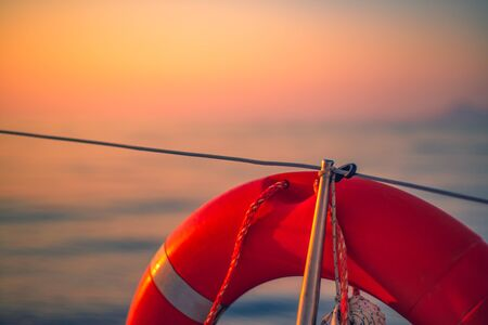Life Preserver on the Deck of a Boat at Sea at Sunrise