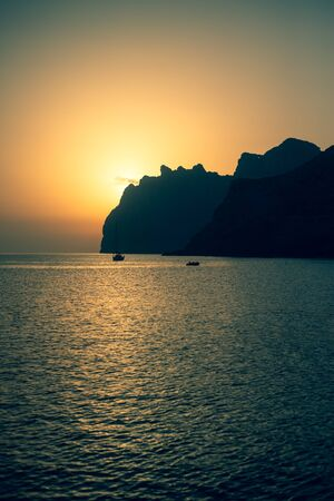 The Sun Rises Behind Cliffs on the Coast of Mallorca