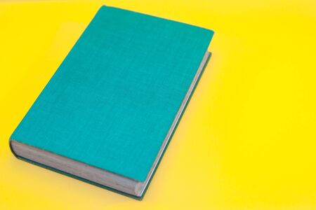 Turquoise Vintage Book WIth Vibrant Yellow Background