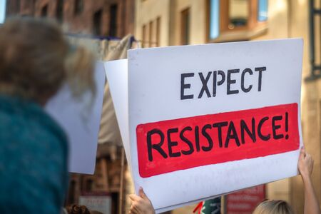 Expect Resistance Banner Held Up at a Climate Protest March in Glasgow Scotland
