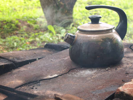 soot: old, covered in soot kettle