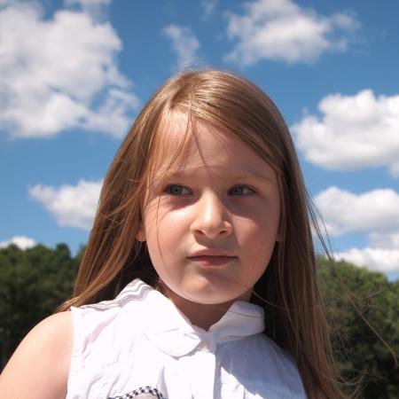 child portrait on the sky background