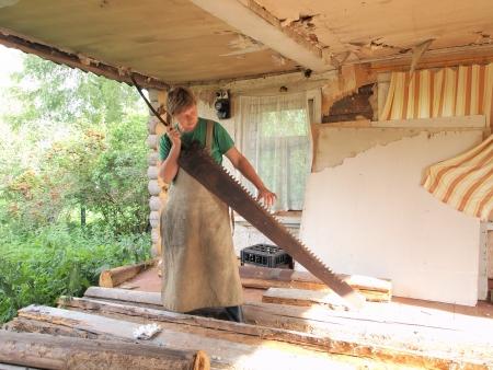 female with a big saw
