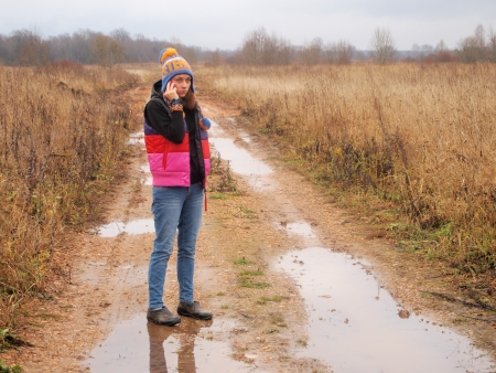 girl with the phone on a rural road Stock Photo