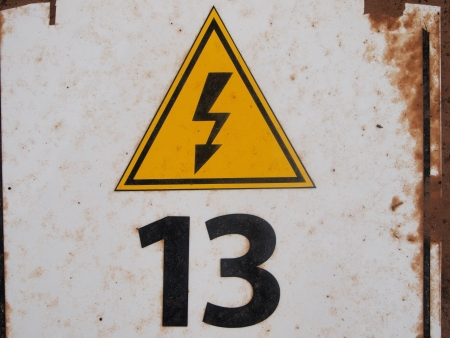 number 13, above it sign of danger Stock Photo