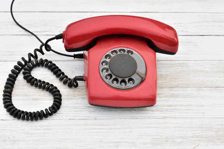 old rotary dial phone, red color Banco de Imagens