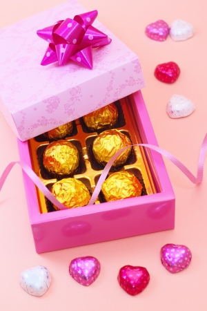 Chocolates in a cute gift box with heart candies photo