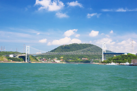 honshu: KITAKYUSHU, JAPAN - AUG 18  Kanmonkyo Bridge on Aug 18, 2013 in Kitakyushu, Japan  Kanmonkyo Bridge is the important bridge linking the islands of Honshu and Kyushu