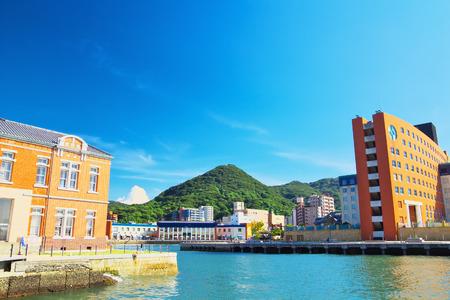 tourist destinations: KITAKYUSHU, JAPAN - AUG 18  View of Mojiko Retro Town on Aug 18, 2013 in Kitakyushu, Japan  Mojiko Retro Town is one of the popular tourist destinations in Kitakyushu