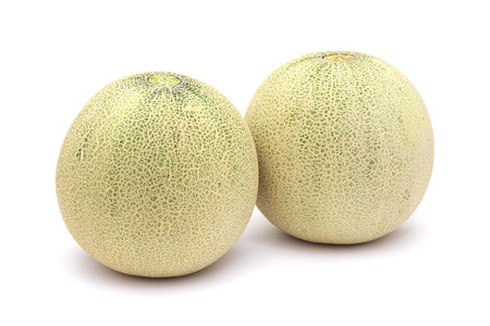 musk: Two melons isolated on white background