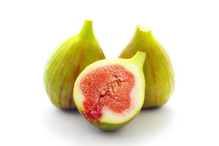 Three fig fruits isolated on white background photo