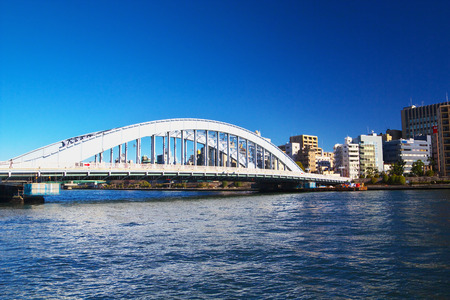 sumida ku: TOKYO-JAN 12: View of Eitai Bridge with the city of Koto area on Jan 12, 2015 in Tokyo, Japan. The bridge has been designated as a national important cultural property in 2007.