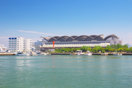 messe: FUKUOKA, JAPAN-JUL 09: View of Hakata Port with Marine Messe Fukuoka on Jul 09, 2015 in Fukuoka, Japan. Marine Messe Fukuoka is arena facility that is used for many events and concerts.