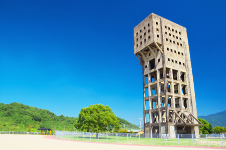 industrial heritage: SHIME, JAPAN-SEP 28: Tower of Shime Coal Mine on Sep 28, 2015 in Shime, Japan. The building was constructed in 1943 and is designated as National Important Cultural Property.