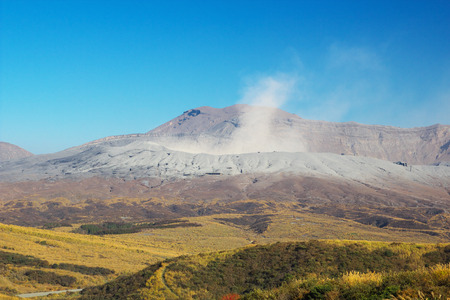 spewing: View of Mt. Aso which is spewing smoke at Autumn