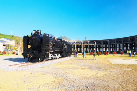 tangible: KUSU, JAPAN-NOV 03: Bungomori Roundhouse with a steam locomotive on Nov 03, by 2015 in Kusu, Oita, Japan. The Roundhouse is one of the nations registered tangible cultural properties.