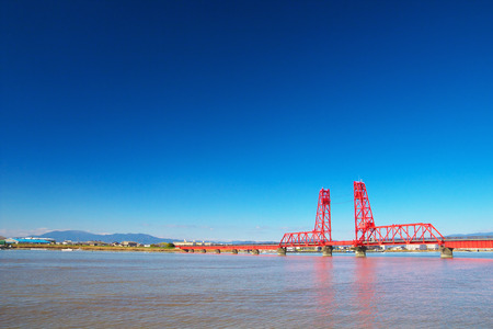 moveable: OKAWA, JAPAN-DEC 18: View of Chikugo River Lift Bridge on Dec 18, 2015 in Okawa, Japan. The bridge was constructed in 1935 and is designated as National Important Cultural Property.