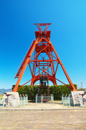 TAGAWA, JAPAN-MAR 26: Winding tower of former Mitsui Tagawa Ita Coal Mine on Mar 26, 2016 in Tagawa, Japan. It was constructed in 1909 and is registered in the registered tangible cultural property.