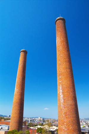 The two chimneys of former Mitsui Tagawa Ita Coal Mine Stock Photo