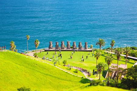 NICHINAN, JAPAN - OCT 30: Sun Messe Nichinan and Moai statues on Oct 30, 2016 in Nichinan, Japan. Sun Messe Nichinan is one of the sightseeing spots in Miyazaki Prefecture, Japan.