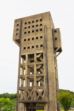 SHIME, JAPAN-OCT 14: Tower of Shime Coal Mine on Oct 14, 2017 in Shime, Japan. The building was constructed in 1943 and is designated as National Important Cultural Property.