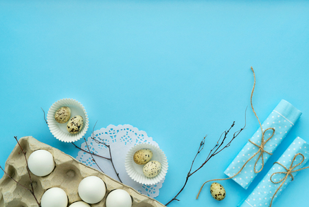 rustic easter composition on blue background with free and copy space top view