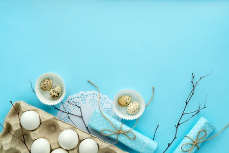 easter composition on blue background with free and copy space