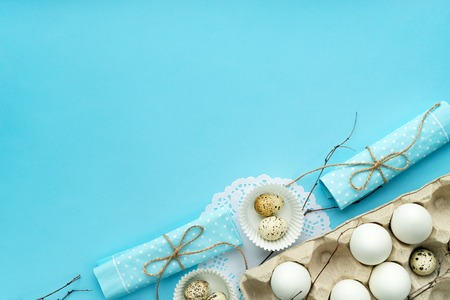 flat lay easter composition on blue background with free and copy space Reklamní fotografie