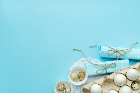 rustic style easter composition isolated on blue with free and copy space Reklamní fotografie