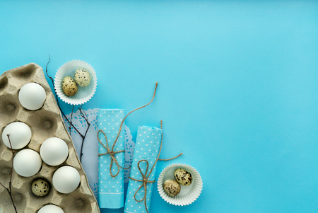 top view easter composition isolated on blue background with free and copy space Reklamní fotografie