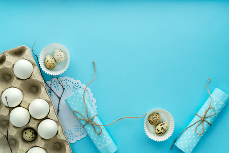 top view easter composition on blue background with free and copy space